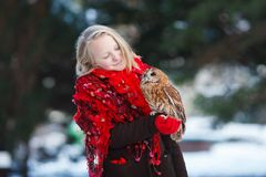 Cute girl with little owl Royalty Free Stock Images