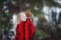 Cute girl with little owl Stock Photo