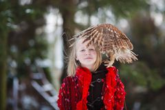 Cute girl with little owl Royalty Free Stock Photos