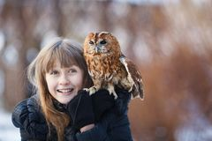 Cute girl with little owl Royalty Free Stock Image