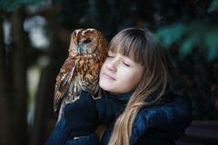 Cute girl with little owl Stock Photos