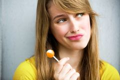 Cute Girl with Lollipop Royalty Free Stock Photography