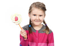 Cute girl with lollipop Stock Photos