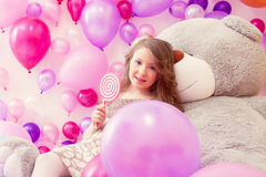 Cute girl with lollipop posing looking at camera Stock Photography