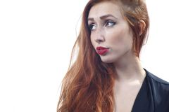 Redhead Girl - Cute Submissive Look. A cute girl with long red hair gives a sultry submissive look Stock Photos