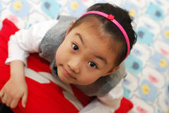 Cute girl look up with a smile. royalty free stock images