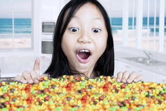 Cute girl looking at colorful candies Stock Photography