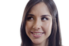 Cute girl looking at copy space. Closeup of a pretty young woman smiling and looking up towards copy space Royalty Free Stock Images