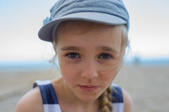 Cute girl is looking with serious face at camera Stock Image