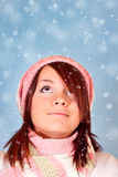Cute girl looking the snowfall Royalty Free Stock Images