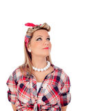Cute girl looking up in pinup style Royalty Free Stock Images