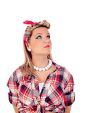 Cute girl looking up in pinup style Stock Images