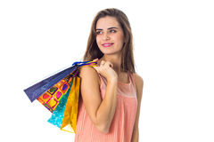 Cute girl looks away and keeps the shoulder bags isolated on white background Stock Photos
