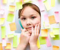 Cute girl with lots of reminder notes Stock Images