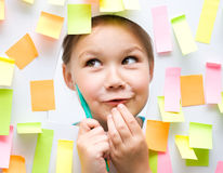 Cute girl with lots of reminder notes Stock Photography