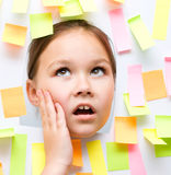 Cute girl with lots of reminder notes Royalty Free Stock Image