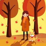 Cute girl and lovely dog walking in morning of autumn Royalty Free Stock Image