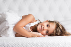 Cute girl lying Stock Image