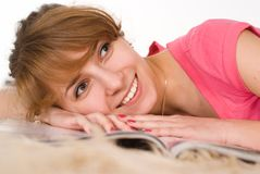 Cute girl lying on the carpet Royalty Free Stock Photos