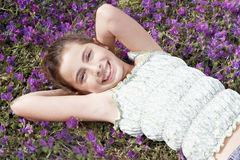 Cute Girl Lying On Field Of Flower Royalty Free Stock Photos