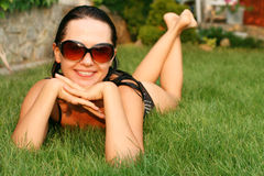 Cute girl lying in the grass Stock Photo