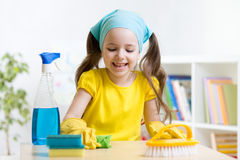 Cute girl make cleaning in the children room at Royalty Free Stock Photos