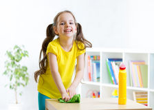 Cute girl make cleaning in the children room at Royalty Free Stock Photography