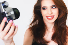 Cute girl make a foto selfie at vintage camera. Royalty Free Stock Images