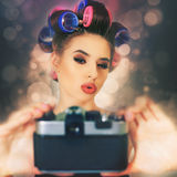 Cute girl make a foto selfie at vintage camera. Stock Images