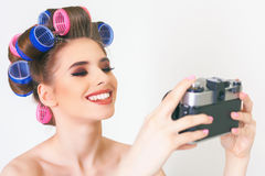 Cute girl make a foto selfie at vintage camera. Royalty Free Stock Image
