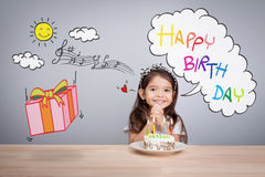 Cute girl make a wish on birthday. Happy Birthday background. Greeting background for card, flyer, poster, sign, banner, web, postcard, invitation. Abstract Stock Photo