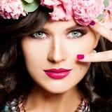 Cute Girl. Makeup and Curly Hair. Face closeup royalty free stock image