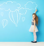 Cute girl making chalk drawings Royalty Free Stock Photo