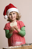 Cute girl making Christmas cookies Royalty Free Stock Image