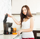 Cute girl making coffee. royalty free stock images