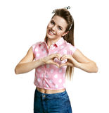 Cute girl making a heart shape with her hands Royalty Free Stock Photo