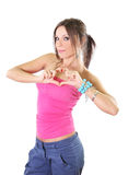 Cute girl making a heart shape sign with her hands Royalty Free Stock Images