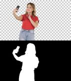 Cute girl making selfie walking, Alpha Channel royalty free stock image