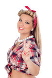 Cute girl making the sign of victory in pinup style. Isolated on a white background Royalty Free Stock Photography