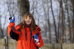 Cute girl making snowballs Stock Photography