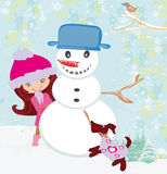 Cute girl making snowman Stock Photos