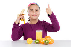 Cute girl with many fruits Royalty Free Stock Images