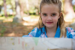 Cute girl with map in forest Royalty Free Stock Image