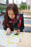 Cute girl with map at open cafe Stock Image