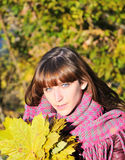 Cute girl with maple leaves Stock Photography