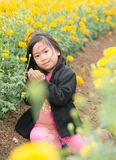 Cute girl in Marigold flower field Royalty Free Stock Photos