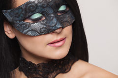 Cute girl in masquerade mask Stock Image
