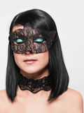 Cute girl in masquerade mask Royalty Free Stock Image