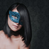 Cute girl in masquerade mask Royalty Free Stock Photography
