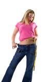 Cute girl measuring her small waist Stock Photos